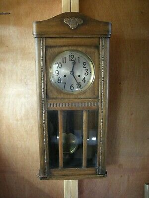 Oak cased wall clock, made in the Black Forest region of Germany c1920.