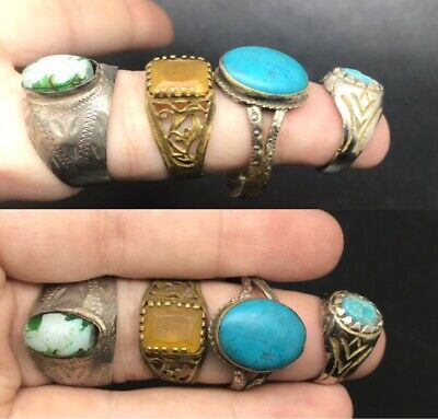 Wonderful 4 old rings with different stones