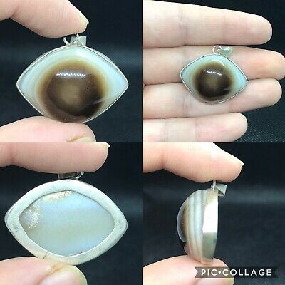 Beautiful wonderful goat eye evil protector agate bead banded with pure silver p