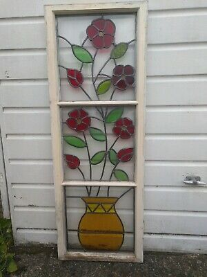 Victorian stained glass window with floral pattern, with restored lead work.