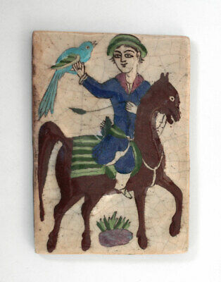 Antique Qajar glazed tile with painting of falconer rider figure