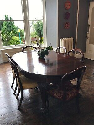 Extendable Victorian Mahogany dining table and 6 chairs