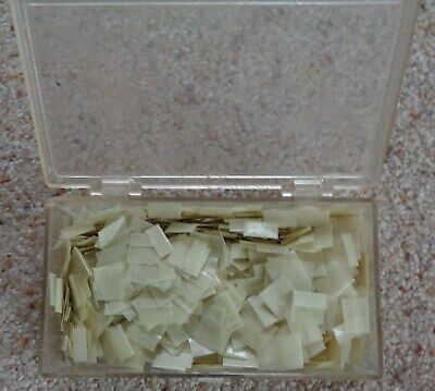 Dennison stamp hinges in 51/2 x 3 x 1 inch box, estimated 1,000 hinges