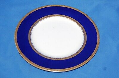 From Minton's, a cobalt and gold salad plate from 1924 for Davis Collamore & Co.