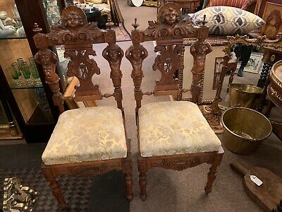 Pair Of Antique Italian Carved Walnut Figural Chairs