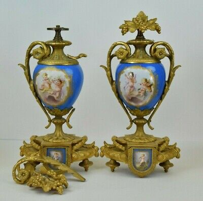 Beautiful Set of 2 P. H. Mourey Ormolu Urns with Possible Sevres Porcelain