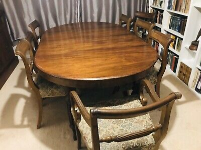 REDUCED FOR QUICK SALE Mahogany dining table and 8 Chairs Plus Heatproof Mats