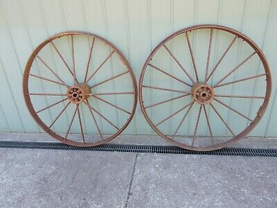 2 Large Vintage Steel Wheels off an old farm machine.