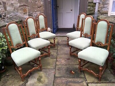 Six 20th century oak framed high back dining chairs in the arts and crafts taste