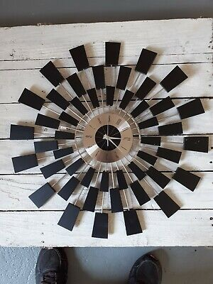 large metal wall clock new. Decent condition.(second hand slightly bent.)