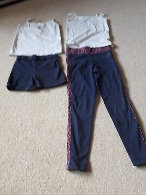 Pineapple navy blue girl's shorts, exercise trousers and white tops. Age 5-6