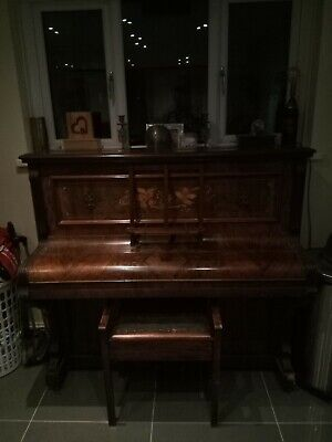 antique upright piano with antique stool