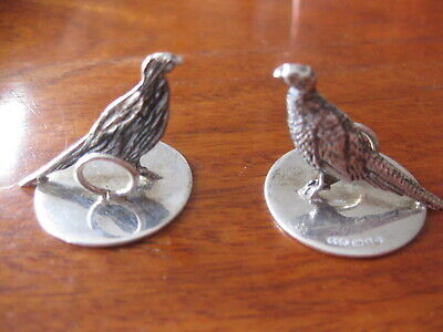 . ViPair hallmarked sterling silver pheasant place card holders