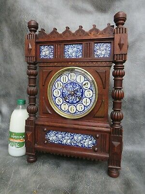 A NICE AESTHETIC MOVEMENT WOOD CASED AND POTTERY PANELLED MANTLE CLOCK by MARTI