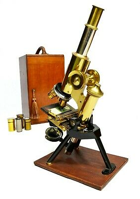 Antique lacquered brass compound microscope by James Swift of London, circa 1910