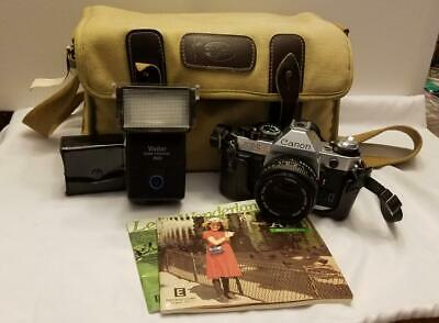 Canon AE-1 Program 35mm SLR Camera with 50mm f/1.8 lens and accessories