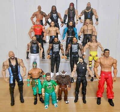 Set of 4 WWE wrestling figures inc. Roman Reigns, Braun Strowman, Brock Lesnar