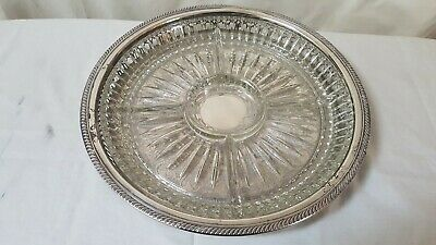 Heavy cut glass compartment dish in ornate silver plated tray