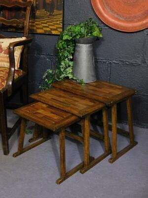A CHARMING NEST OF ANTIQUE TABLES in the ARTS & CRAFTS MANNER