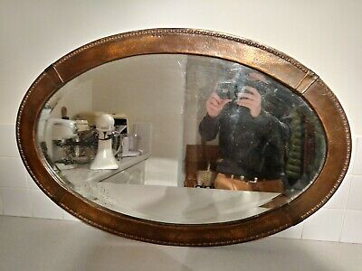 ARTS & CRAFTS BEVELLED GLASS OVAL MIRROR IN COPPER FRAME EARLY 1900's