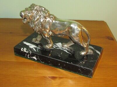 Silver plated lion sculpture on a marble base