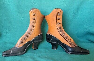 A Pair of Miniature Victorian Carved Wooden Button-Up Boots