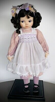 An Authentic Beautiful Franklin Mint Porcelain Doll With Black Hair On Stand