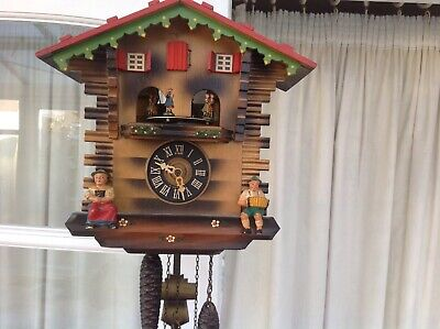 Vintage cuckoo clock With Music Box And Figures