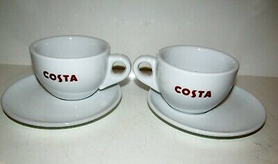 A pair of COSTA COFFEE  CUPS WITH HANDLE WITH SAUCER