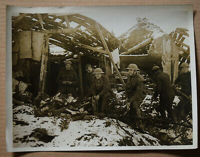 WW1 press photograph British Tommies collecting fire wood France wrecked house