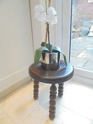 Vintage French round bulls eye milking stool, turned seat, 3 legs, plant stand