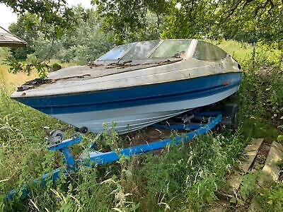 Bayliner boat with inboard engine and trailer