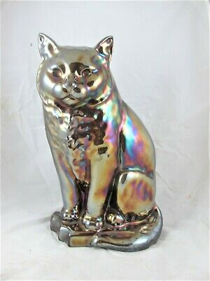 Bretby cat cast iron, iridescent glazed, with fire tools c1920's