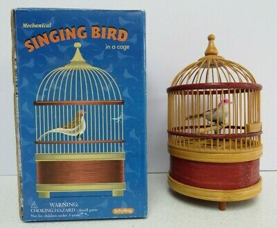 Vintage Boxed Toy Mechanical Singing bird in Bamboo Cage By Schylling Movement