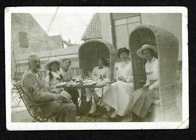 Vintage small photo - wonderful group enjoying meal, Orkney chairs? - Edwardian?