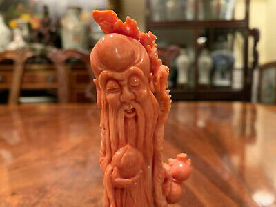 A Chinese Antique Carved Coral Shou Lao with Rosewood Stand