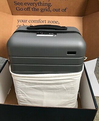 "AWAY TRAVEL luggage ""THE BIGGER CARRY ON"" + EJECTABLE BATTERY. Asphalt BRAND NEW"