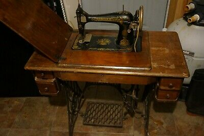 Antique Singer 127 Sphinx Treadle Sewing Machine Model with bench