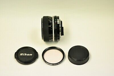 Nikon Nikkor 28mm f3.5 non AI manual focus lens with caps and a 52mm Skylight