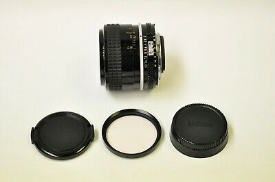 Nikon Nikkor 35mm f2.0 AI manual focus lens with caps and a 52mm Skylight. READ.