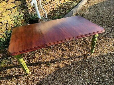 Antique Victorian solid mahogany telescopic dining table with extending leaf