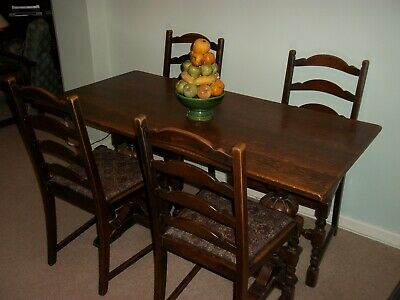 antique solid oak dining table with 4 chairs