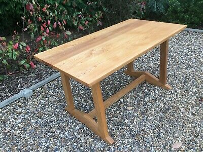 An arts and crafts Elm dining table.