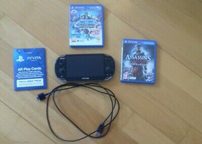 PlayStation Vita WIFI 512 Mo + Chargeur et 3 jeux