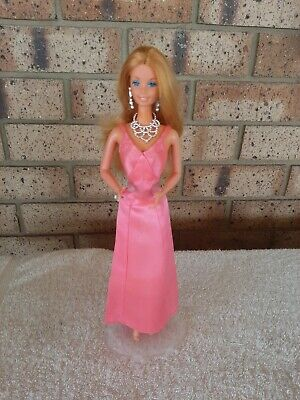 Fashion Photo  Barbie 1977 dressed in superstar dress plastic stand included