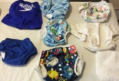 AFFORDABLE  8 Piece Diaper Cover Lot Includes Diaper Covers, Pool Suits & Pad