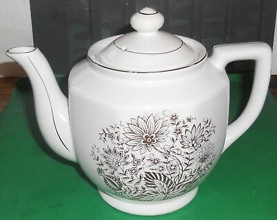 Teapot With Gold Pattern