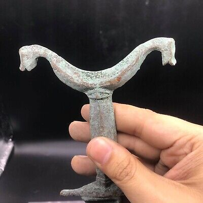 Ancient roman empire warrior short bronze sword with two animal on site of the h