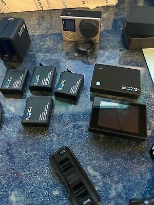 GoPro Hero4 Black Action Camera, 5 Batteries, and Bundle of Accessories