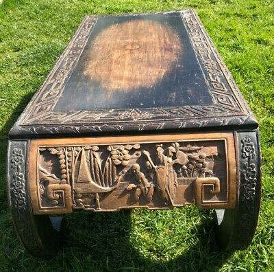 1920s Heavily carved Chinese elm scroll legged tea table